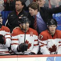 Photo - FILE - In this Feb. 28, 2010, file photo, Canada coach Mike Babcock speaks with players Eric Staal, Jarome Iginla, center, and Sidney Crosby (87) during the men's gold medal ice hockey game at the 2010 Olympics in Vancouver, British Columbia. Canada won the gold on home ice in 2010; now Babcock will try to lead the team to victory in Sochi. (AP Photo/Mark Humphrey, File)