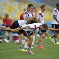 Photo - Germany's Thomas Mueller, in front, and Germany's Miroslav Klose, behind him,  exercise during an official training session one day before the World Cup quarterfinal soccer match between Germany and France at the Maracana Stadium in Rio de Janeiro, Brazil, Thursday, July 3, 2014. (AP Photo/Martin Meissner)