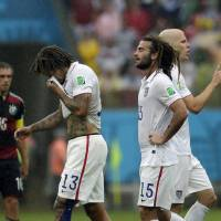 Photo - United States' Jermaine Jones (13), Kyle Beckerman (15) and Michael Bradley, far right, walk over the pitch during the group G World Cup soccer match between the USA and Germany at the Arena Pernambuco in Recife, Brazil, Thursday, June 26, 2014. (AP Photo/Petr David Josek)