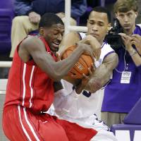 Photo - TCU's Garlon Green, right, tries to strip the ball from Houston's Mikhail McLean during their NCAA college basketball game, Tuesday, Dec. 4, 2012, in Fort Worth, Texas. Houston won 54-48. (AP Photo/The Fort Worth Star-Telegram, Ron T. Ennis)  MAGS OUT; (FORT WORTH WEEKLY, 360 WEST); INTERNET OUT