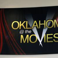 Photo - Visitors to the Oklahoma History Center's movies' exhibit can see a glimpse of 73 movies filmed in the state. PHOTO BY DOUG HOKE, THE OKLAHOMAN.  DOUG HOKE