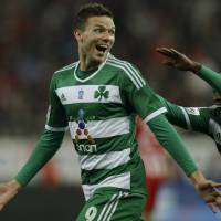 Photo - Panathinaikos' Marcus Berg of Sweden celebrates after scoring the second goal of his team against Olympiakos during a Greek League soccer match at Georgios Karaiskakis stadium, in Piraeus port, near Athens, on Sunday, March 2, 2014. (AP Photo/Thanassis Stavrakis)
