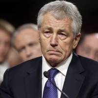 Photo - FILE - In this Jan. 31, 2013, file photo, Republican Chuck Hagel, President Obama's choice for Defense Secretary, testifies before the Senate Armed Services Committee during his confirmation hearing on Capitol Hill in Washington. Senate Republicans on Feb. 14, 2013, temporarily blocked a full Senate vote on Hagel's nomination as defense secretary.(AP Photo/J. Scott Applewhite, File)