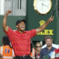 Photo - FILE - In this July 23, 2006, file photo, Tiger Woods of the  United States, right, celebrates after winning the British Open Golf Championship at the Royal Liverpool Golf Course in Hoylake, England. The British Open golf championship returns to Royal Liverpool on Thursday July 17, 2014. (AP Photo/Jon Super, File)