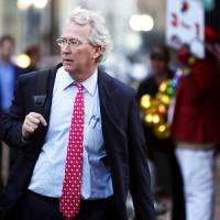 Photo - Chesapeake Energy Corp. CEO Aubrey McClendon walks March 26 through the French Quarter in New Orleans. REUTERS PHOTO  REUTERS