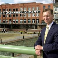 Photo -  Jeff Brown is shown in this 2000 photo in front of his building, the Miller Jackson Building, along the Bricktown Canal before it was home to a string of nightclubs where assaults and two slaying have taken place. Photo by Jim Beckel, The Oklahoman   JIM BECKEL