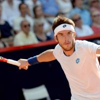 Photo - Leonardo Mayer of Argentina returns a shot to Germany's Philipp Kohlschreiber in their semi final match at the German Open tennis tournament in Hamburg, Germany, Saturday, July 19, 2014. Mayer won the match with 7-5 and 6-4. (AP Photo/dpa, Daniel Reinhardt)