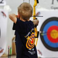 Photo - James Ryan, 9, from Trinity Christine Academy in Lawton, competes in  the Oklahoma's National Archery in the Schools Program State Shoot in the Travel and Transportation Building at the State Fair Park, Wednesday, March 27, 2013. Photo By David McDaniel/The Oklahoman