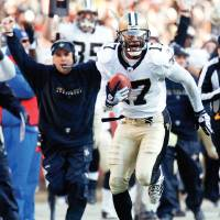 Photo - New Orleans Saints wide receiver Robert Meachem (17) carries the ball for a touchdown in the second quarter during an NFL football game against the Washington Redskins, Sunday, Dec. 6, 2009, in Landover, Md. (AP Photo/Gerald Herbert) ORG XMIT: FDX108
