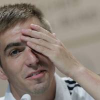 Photo - Germany's national soccer team captain Philipp Lahm attends a news conference in Porto Seguro, Brazil, Tuesday, June 10, 2014. Germany will play in group G of the Brazil 2014 soccer World Cup. (AP Photo/Matthias Schrader)