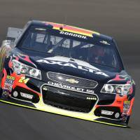 Photo - Jeff Gordon drives through turn one during practice for the Brickyard 400 Sprint Cup series auto race at the Indianapolis Motor Speedway in Indianapolis, Saturday, July 26, 2014. (AP Photo/Darron Cummings)