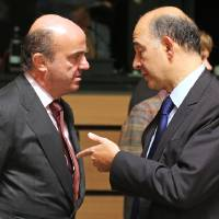 Photo -   French Finance Minister Pierre Moscovici, right, talks with Spanish Finance Minister Luis de Guindos Jurado, at the EU finance ministers meeting, in Luxembourg, Tuesday Oct. 9, 2012. EU finance ministers assess the budgetary situation in Portugal and address the challenges of the European financial crisis. (AP Photo/Yves Logghe)