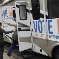 Photo -   State Auditor Rebecca Otto enters the RV at a stop in Edina, Minn., on the