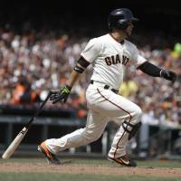 Photo - San Francisco Giants' Gregor Blanco swings for a single off Cleveland Indians' Zach McAllister in the fifth inning of a baseball game on Saturday, April 26, 2014, in San Francisco. (AP Photo/Ben Margot)