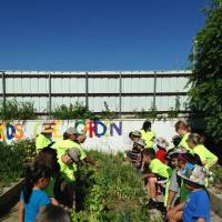 Photo -  Oklahoma County Master Gardeners help children in the Urban Mission after-school program grow vegetables in their own garden spaces. Photo provided