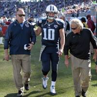Photo - Tennessee Titans quarterback Jake Locker (10) leaves the field after injuring his foot in the second quarter of an NFL football game against the Jacksonville Jaguars on Sunday, Nov. 10, 2013, in Nashville, Tenn. (AP Photo/Wade Payne)