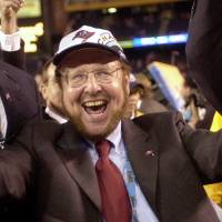 Photo - FILE - In this Jan. 26, 2003 file photo, Tampa Bay Buccaneers owner Malcolm Glazer celebrates the Bucs' 48-21 victory over the Oakland Raiders in Super Bowl XXXVII in San Diego. Glazer, the self-made billionaire who owned the NFL's Tampa Bay Buccaneers and English soccer's Manchester United, has died.  He was 85. The Bucs said Glazer died Wednesday, May 28, 2014.  (AP Photo/Dave Martin, File)