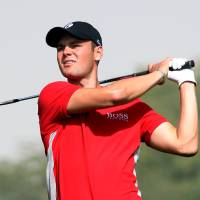 Photo - Martin Kaymer of Germany plays his shot on the 18th  hole during the Second  round of the Commercial Bank Qatar Masters held at the Doha Golf Club in Qatar, Thursday, Jan. 24, 2013. (AP Photo/Osama Faisal)