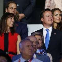 Photo -   Britain's Prince William, the Duke of Cambridge, back left, and his wife Catherine, Duchess of Cambridge, back right, Britain's Prime Minister David Cameron, front right, and his wife Samantha, front left, watch the Opening Ceremony at the 2012 Summer Olympics, Friday, July 27, 2012, in London. (AP Photo/Matt Dunham)
