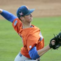 Photo - Florida's A. J. Puk throws a pitch against Tennessee during an NCAA college baseball game Friday, May 16, 2014 in Knoxville, Tenn. (AP Photo/The Daily Times, Daryl Sullivan)