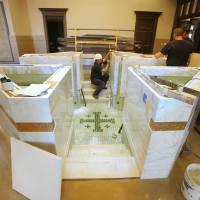 Photo - Crew members work to complete the  baptismal inside the new church building under construction at St. Eugene Catholic Church, 2400 W Hefner Road in The Village.  PAUL B. SOUTHERLAND - PAUL B. SOUTHERLAND