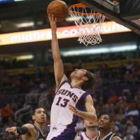 Photo -   Phoenix Suns' Steve Nash scores against the San Antonio Spurs during the second half of an NBA basketball game, Wednesday, April 25, 2012, in Phoenix. (AP Photo/Matt York)