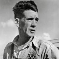 Photo - Horace Bristol (1908-1997)  Tom Joad, from The Grapes of Wrath Series, 1938  Black and white silver gelatin print, 11 1/4 x 9 9/16 in.  The Horace and Masako Bristol Trust