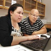 Photo - University of Texas at Arlington graduate student Andrea Muru helps Hutke Fields, principal chief of the Natchez Nation, in an effort to revive his tribal language.