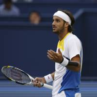 Photo -   Feliciano Lopez of Spain reacts after losing a point to Novak Djokovic of Serbia during their third round men's singles match of the Shanghai Masters tennis tournament at Qizhong Forest Sports City Tennis Center in Shanghai, China, Thursday Oct. 11, 2012. Novak Djokovic won 6-3, 6-3. (AP Photo/Kin Cheung)
