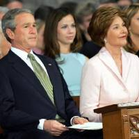 Photo - 2005 file photo - President George W. Bush attends the 55th Presidential Inaugural Prayer service at Washington's National Cathedral, Friday, Jan. 21, 2005 with first lady Laura Bush and daughters Barbara Bush, second from left, and Jenna Bush, right. (AP Photo/Susan Walsh)