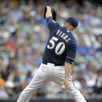 Photo - Milwaukee Brewers pitcher Mike Fiers throws to the Los Angeles Dodgers during the first inning of a baseball game Saturday, Aug. 9, 2014, in Milwaukee. (AP Photo/Darren Hauck)