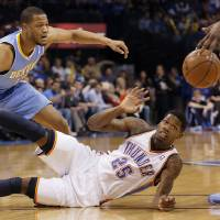 Photo - Oklahoma City's DeAndre Liggins (25) gets a steal from Denver's Anthony Randolph (15) during the NBA basketball game between the Oklahoma City Thunder and the Denver Nuggets at the Chesapeake Energy Arena on Wednesday, Jan. 16, 2013, in Oklahoma City, Okla.  Photo by Chris Landsberger, The Oklahoman