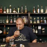 Photo - In this Thursday, April 25, 2013 photo Petr Nemy, an whisky expert, tastes the single malt