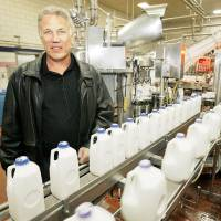 Photo - Drew Braum stands in the Braum's milk production facility in Tuttle. PHOTO BY David McDaniel, The Oklahoman
