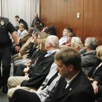 Photo - A courtroom packed with parole officers and family members of the victim and defendant attends the preliminary hearing Friday for Lester Kinchion Jr. at the Oklahoma County Courthouse in Oklahoma City.  Photo by Paul B. Southerland, The Oklahoman