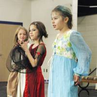 "Photo - Fourth-graders Asher Bartlett as Cinderella, Gwenyth Green as the stepmother and Morgan Jones as Drizella perform in ""Cinderella."""