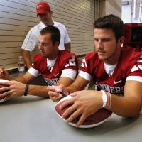 Photo - OU COLLEGE FOOTBALL: Quarterbacks Landry Jones and Drew Allen sign autographs during the Meet the Sooners event inside Gaylord Family/Oklahoma Memorial Stadium at the University of Oklahoma on Saturday, Aug. 4, 2012, in Norman, Okla.  Photo by Steve Sisney, The Oklahoman