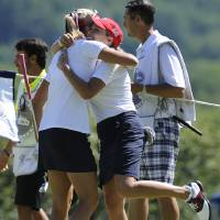 Photo - Lexi Thompson, left, and Christie Kerr celebrate after defeating Spain on the 16th hole during the second round of the International Crown golf tournament Friday, July 25, 2014, in Owings Mills, Md. (AP Photo/Gail Burton)