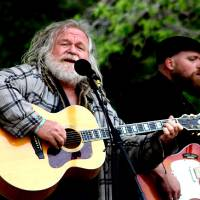 Photo - Local musician Bob Moore, left, joins Byron White of the Damn Quails during the band's performance Sunday at the Rose Rock Music Festival in Noble. PHOTO BY LYNETTE LOBBAN, FOR THE OKLAHOMAN