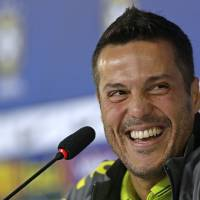 Photo - Brazil's goalkeeper Julio Cesar smiles during a press conference after a training session of the Brazilian national soccer team in Teresopolis, Brazil, Thursday, June 19, 2014. Brazil plays in group A of the 2014 soccer World Cup. (AP Photo/Andre Penner)