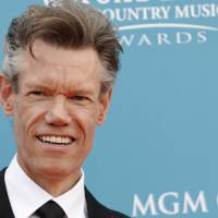 Photo -   FILE - This April 18, 2010 file photo shows singer Randy Travis at the 45th Annual Academy of Country Music Awards in Las Vegas. Travis has been charged with driving while intoxicated in North Texas. The Grayson County Sheriff's Office says Travis was being jailed without bond Wednesday, Aug. 8, 2012, pending an appearance before a judge in Sherman, about 60 miles north of Dallas. Sgt. Rickey Wheeler says Travis also faces a charge of retaliation or obstruction. (AP Photo/Dan Steinberg, file)