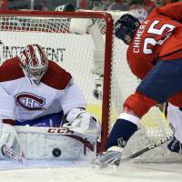 Photo - Montreal Canadiens goalie Carey Price (31) blocks a shot by Washington Capitals left wing Jason Chimera (25) in the first period of an NHL hockey game on Thursday, Jan. 24, 2013, in Washington. (AP Photo/Alex Brandon)