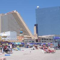 Photo - This July 23, 2014 photo shows the Showboat, left, and Revel, right, two Atlantic City N.J. casinos that are due to close by mid-September. Possible uses for former casino buildings include office space, non-gambling hotels or even student housing, according to analysts and businesspeople. (AP Photo/Wayne Parry)