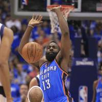 Photo -   Oklahoma City Thunder guard James Harden (13) looses control of the ball when he drives into Dallas Mavericks shooting guard Vince Carter (25) during the first half of Game 4 in a first-round NBA basketball playoff series, Saturday, May 5, 2012, in Dallas. (AP Photo/LM Otero)