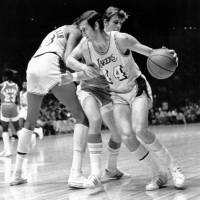 Photo - Los Angeles Lakers' Jerry West (14) is fouled as he tries to get around Houston Rockets' John Vallely after teammate Wilt Chamberlain set screen in game at the Forum in Inglewood, Calif., on Dec. 27, 1971.  The Lakers went on to their 28th straight win, beating the Rockets 137-115.  (AP Photo) ORG XMIT: APHS199