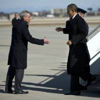 Photo - President Barack Obama, right, is greeted by Chicago Mayor Rahm Emanuel after arriving at Chicago O'Hare International Airport in Chicago, Friday, Feb. 15, 2013. The president Obama went to Chicago to pitch his