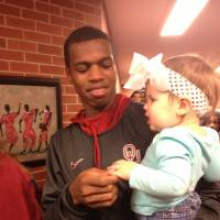 Photo -  Oklahoma men's basketball guard Buddy Hield and a little Sooner fan named Kayleigh