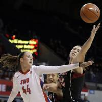 Photo - SMU guard Mallory Singleton (44) and Louisville forward Sara Hammond (00) battle for a rebound in the first half of an NCAA college basketball game on Sunday, Jan. 19, 2014, in Dallas. (AP Photo/Brandon Wade)
