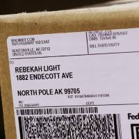 Photo - This package carries a shipping label to North Pole, Alaska. It was among packages at the FedEx shipping center Oklahoma City on Monday,  Dec. 12, 2011.    Photo by Jim Beckel, The Oklahoman