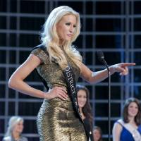 Photo - This photo courtesy Miss America Organization shows Miss DC, Allyn Rose, during preliminary competition at the 2013 Miss America Pageant in Las Vegas, Tuesday, Jan. 8, 2013.  Win or lose, Saturday's Miss America competition will be Rose's last pageant. The 24-year-old plans to undergo a double mastectomy after the event as a preventative measure to reduce her chances of developing the disease that killed her mother, grandmother and great aunt. (AP Photo/Courtesy Miss America Organization)